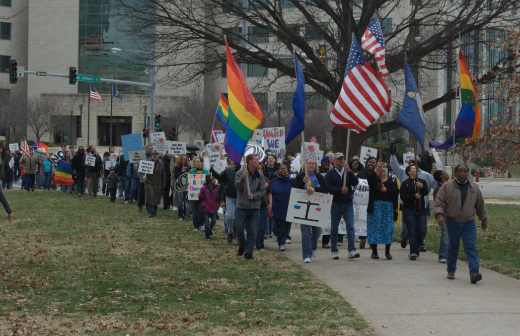 Equality Kansas and NAACP members march on the Kansas Statehouse to protest voter suppression